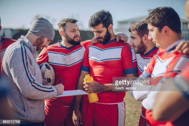 Coach talking to rugby players during time out