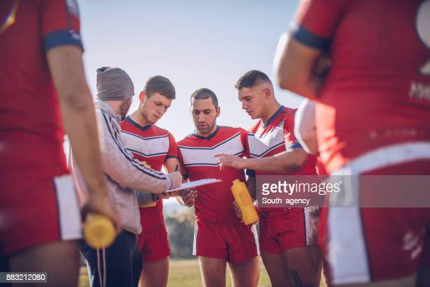 Coach talking to rugby players