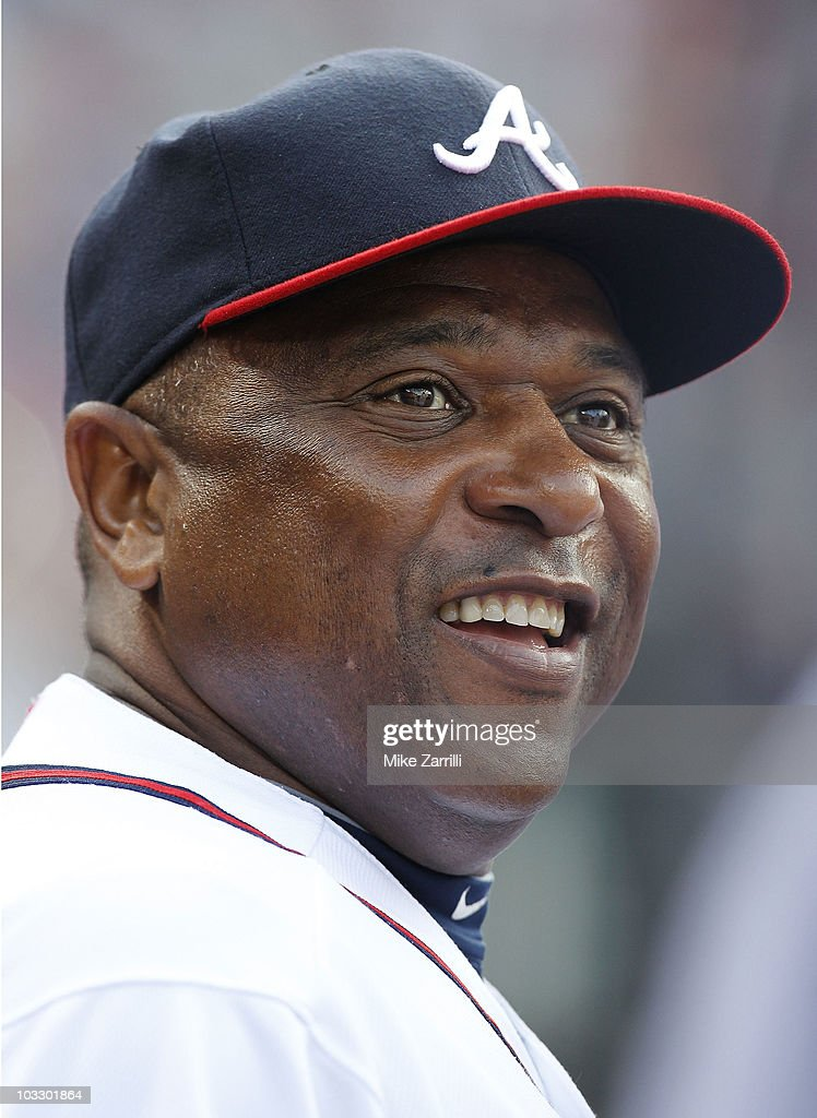 Coach Terry Pendleton #9 of the Atlanta Braves laughs during the game against the San Francisco Giants at Turner Field on August 7, 2010 in Atlanta, Georgia. The Braves beat the Giants 3-0.