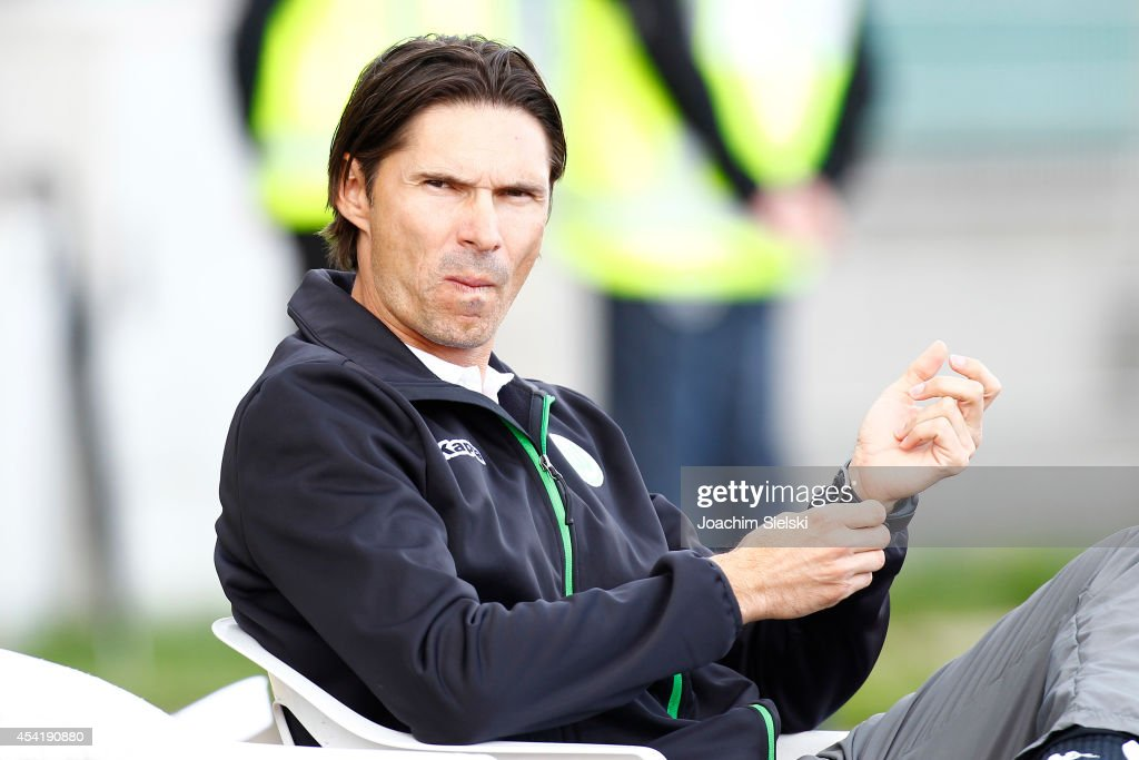 Coach <a gi-track='captionPersonalityLinkClicked' href=/galleries/search?phrase=Thomas+Brdaric&family=editorial&specificpeople=224076 ng-click='$event.stopPropagation()'>Thomas Brdaric</a> of Wolfsburg challenges # of Hamburg during the third league match between VfL Wolfsburg II and Hamburger SV II at VfL Stadion am Elsterweg on August 24, 2014 in Wolfsburg, Germany.