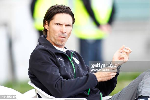 Coach Thomas Brdaric of Wolfsburg challenges # of Hamburg during the third league match between VfL Wolfsburg II and Hamburger SV II at VfL Stadion...