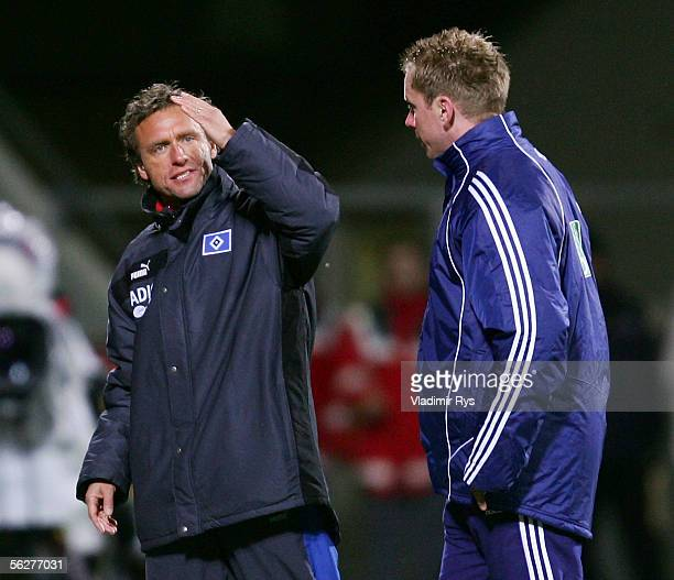 Coach Thomas Doll of Hamburg protests by assistant referee Christian Fischer during the Bundesliga match between Bayer Leverkusen and Hamburger SV at...