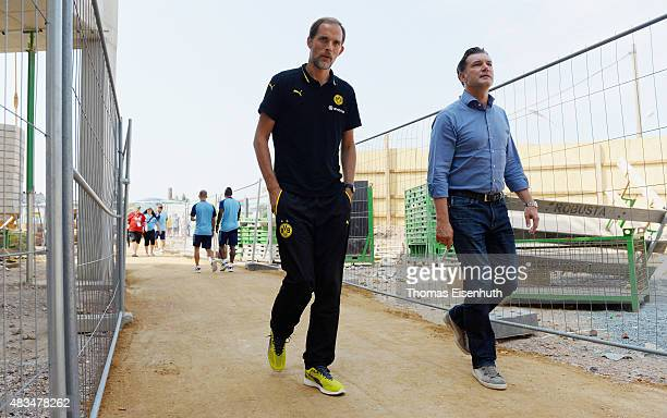 Coach Thomas Tuchel and manager Michael Zorc of Dortmund enter the stadium prior the DFB Cup first round match between Chemnitzer FC and Borussia...