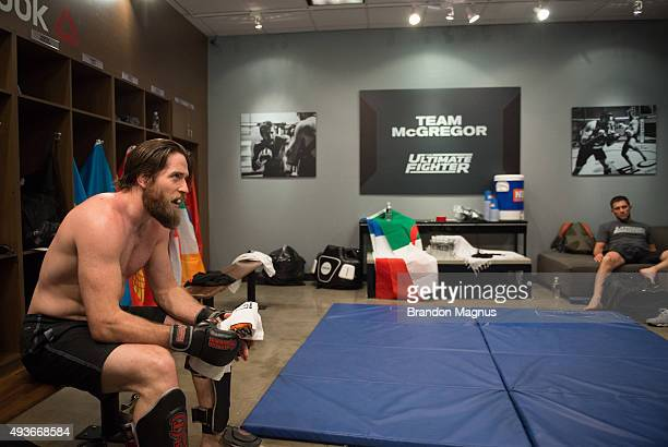 Coach Tom Egan watches as Mehdi Baghdad warms up before facing Julian Erosa during the filming of The Ultimate Fighter Team McGregor vs Team Faber at...