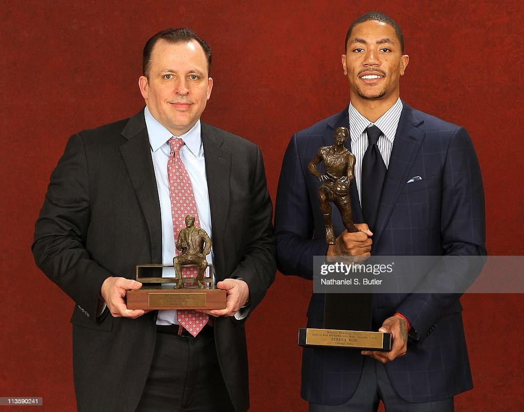 Coach Tom Thibodeau of the Chicago Bulls poses with the 2010-11 Kia NBA Coach of the Year Award alongside Derrick Rose with the Kia NBA Most Valuable Player Award on May 3, 2011 in Lincolnshire, Illinois.