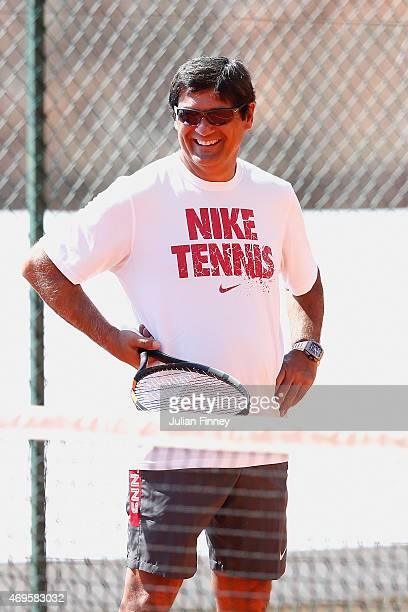 Coach Toni Nadal smiles as Rafael Nadal of Spain is in a practice session during day two of the Monte Carlo Rolex Masters tennis at the MonteCarlo...