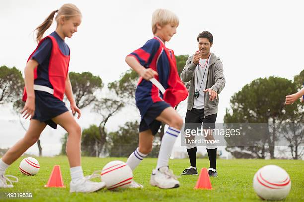 Coach training childrens soccer team