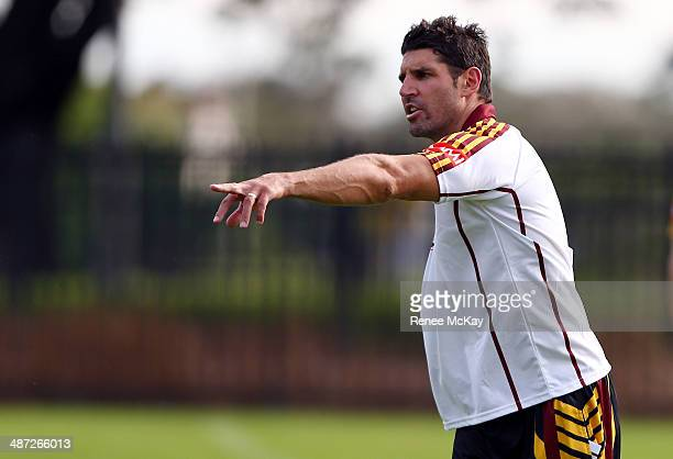Coach Trent Barrett calls instruction to his team during a Country Origin training session at Kippax Lake on April 29 2014 in Sydney Australia