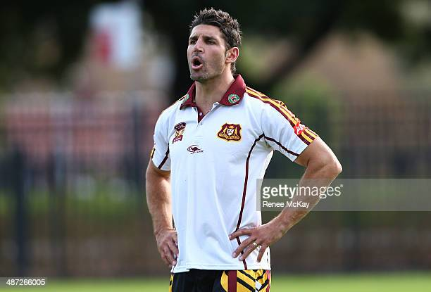 Coach Trent Barrett shouts to his team during a Country Origin training session at Kippax Lake on April 29 2014 in Sydney Australia