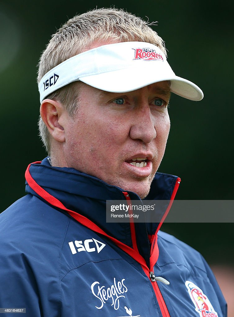 Coach Trent Robinson talks with staff during a Sydney Roosters NRL training session at Kippax Lake on April 7, 2014 in Sydney, Australia.