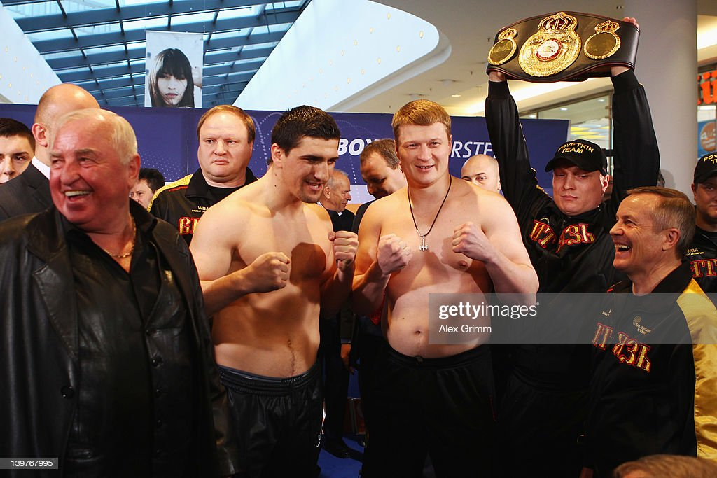 Coach Uli Wegner, <a gi-track='captionPersonalityLinkClicked' href=/galleries/search?phrase=Marco+Huck&family=editorial&specificpeople=2264905 ng-click='$event.stopPropagation()'>Marco Huck</a> of Germany, <a gi-track='captionPersonalityLinkClicked' href=/galleries/search?phrase=Alexander+Povetkin&family=editorial&specificpeople=2351769 ng-click='$event.stopPropagation()'>Alexander Povetkin</a> of Russia and coach Alexander Zimin (L-R) pose during the weigh in for their upcoming WBA World Championship Heavyweight fight at Cannstatter Carré on February 24, 2012 in Stuttgart, Germany.
