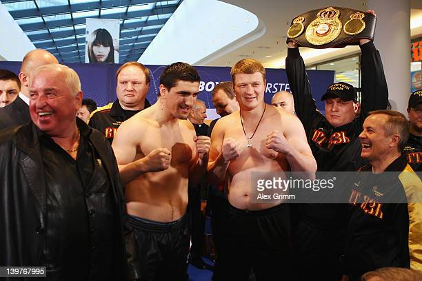 Coach Uli Wegner Marco Huck of Germany Alexander Povetkin of Russia and coach Alexander Zimin pose during the weigh in for their upcoming WBA World...