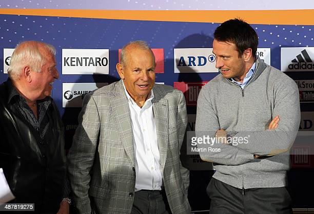 Coach Uli Wegner of Germany promoter Wilfried Sauerland of Germany and Kalle Sauerland of Germany look on during the weigh in at Maritim pro Arte...