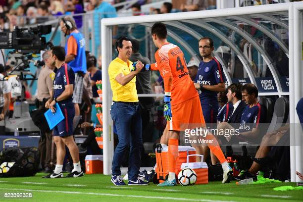 PSG coach Unai Emery prepares to send on Remy Descamps of PSG for his debut during the International Champions Cup match between Paris Saint Germain...
