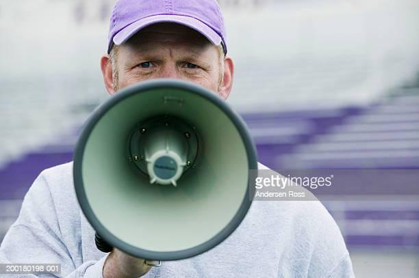 Coach using megaphone, portrait