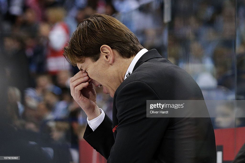 Coach <a gi-track='captionPersonalityLinkClicked' href=/galleries/search?phrase=Uwe+Krupp&family=editorial&specificpeople=655482 ng-click='$event.stopPropagation()'>Uwe Krupp</a> of Cologne reacts during the DEL 1 Bundesliga match between Hamburg and Cologne at O2 World on December 7, 2012 in Hamburg, Germany.