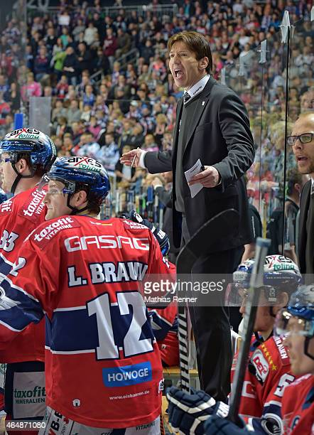 Coach Uwe Krupp of the Eisbaeren Berlin gestures during the game between Eisbaeren Berlin and Iserlohn Roosters on March 1 2015 in Berlin Germany