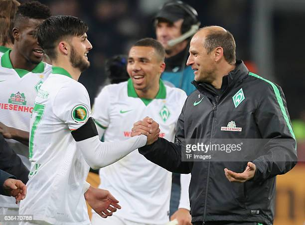 Coach Viktor Skripnik of Werder Bremen shakes hands with Florian Grillitsch of Werder Bremen during the DFB Pokal soccer match between Bayer 04...