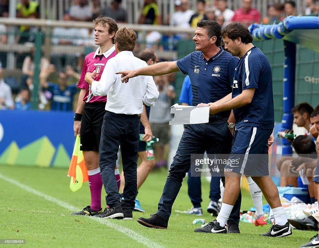 Coach <a gi-track='captionPersonalityLinkClicked' href=/galleries/search?phrase=Walter+Mazzarri&family=editorial&specificpeople=5314636 ng-click='$event.stopPropagation()'>Walter Mazzarri</a> reacts during the pre-season friendly match between FC Internazionale and AC Prato on July 20, 2014 in Pinzolo near Trento, Italy.