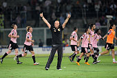 Coach Walter Zenga and players of Palermo celebrate the victory after the Serie A match played between US Citta di Palermo and Juventus FC at Stadio...