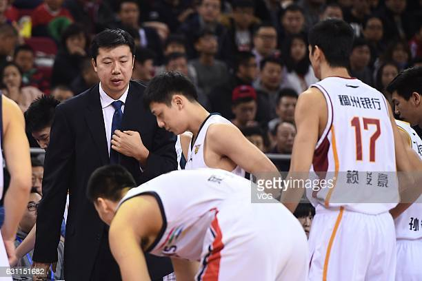 Coach Wang Zhizhi gives guidance to Southern Team players in warmup before the Rookie Game between Southern Team and Northern Team as part of 2017...