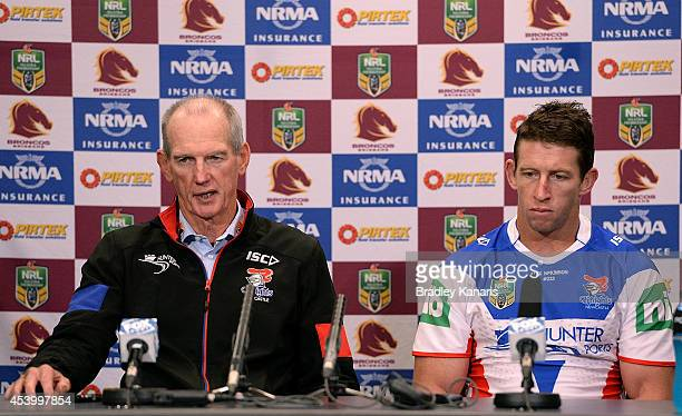 Coach Wayne Bennett and Knights captain Kurt Gidley talk at a post match press conference after the round 24 NRL match between the Brisbane Broncos...
