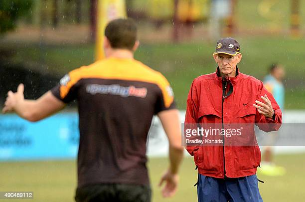 Coach Wayne Bennett gives Corey Oates some advice during the Brisbane Broncos NRL training session on September 29 2015 in Brisbane Australia
