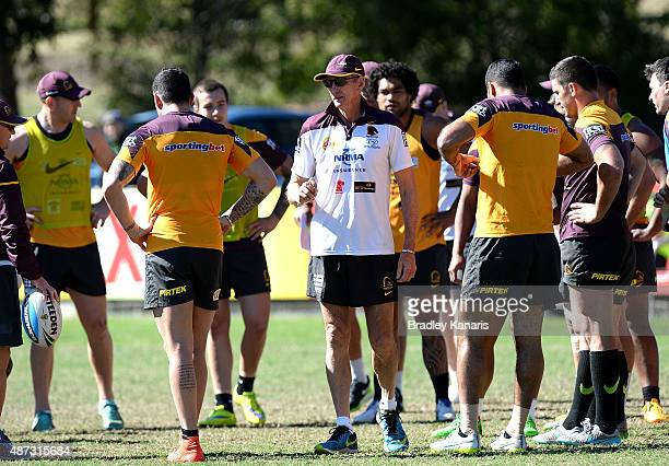 Coach Wayne Bennett talks to his players during a Brisbane Broncos NRL training session on September 9 2015 in Brisbane Australia