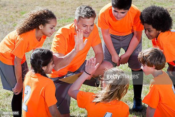 Coach with children's sports team