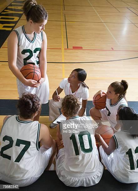 Coach with female basketball team