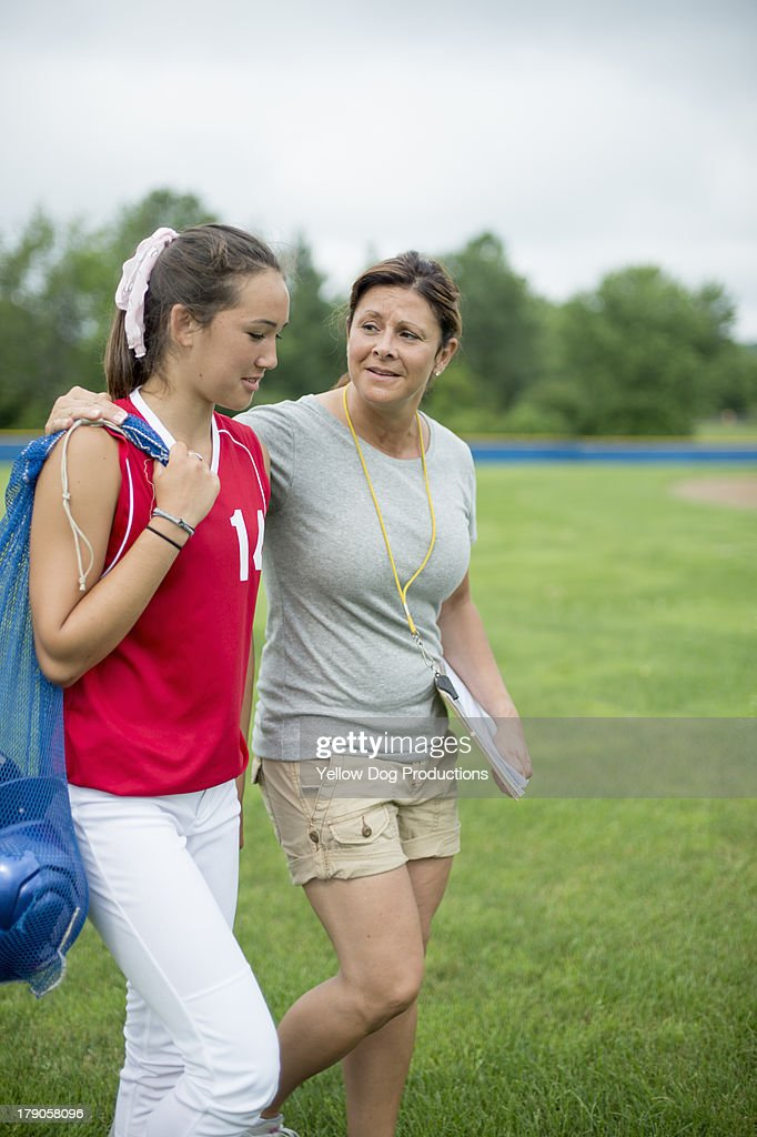 Coach with Teen Girl Softball Player : Stock Photo