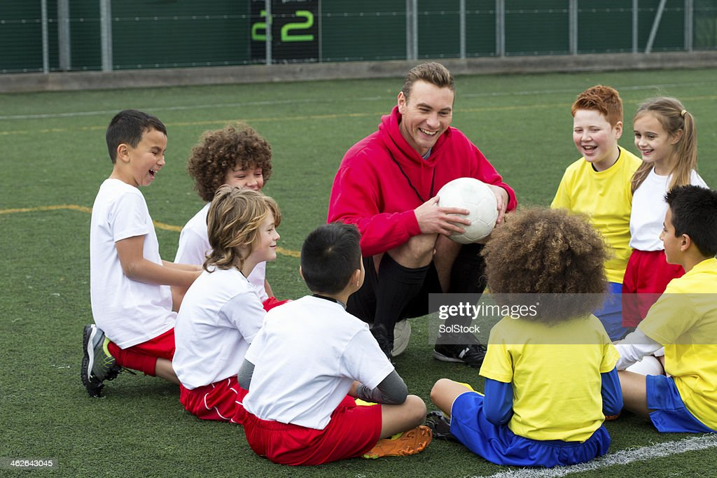Coach with Young Player