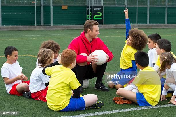 Entraîneur avec les jeunes joueurs