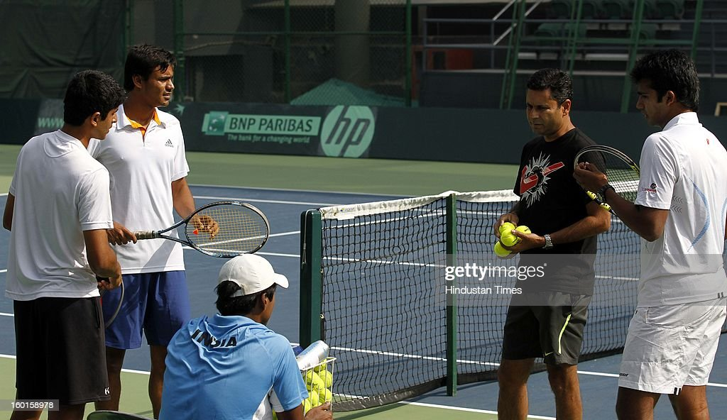 Coach Zeeshan Ali with the young Davis cup team during practice session at Delhi Lawn Tennis Association on January 27, 2013 in New Delhi, India.