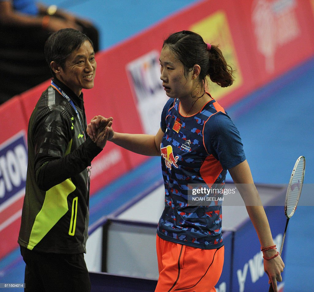 Coach Zhong Bo L greets Yu Sun of China after her win against