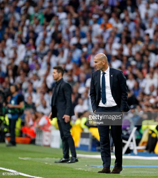 coach Zidenine Zidane of Real Madrid and coach Cholo Simeone of Atletico de Madrid looks on during the UEFA Champions League semifinal first leg...