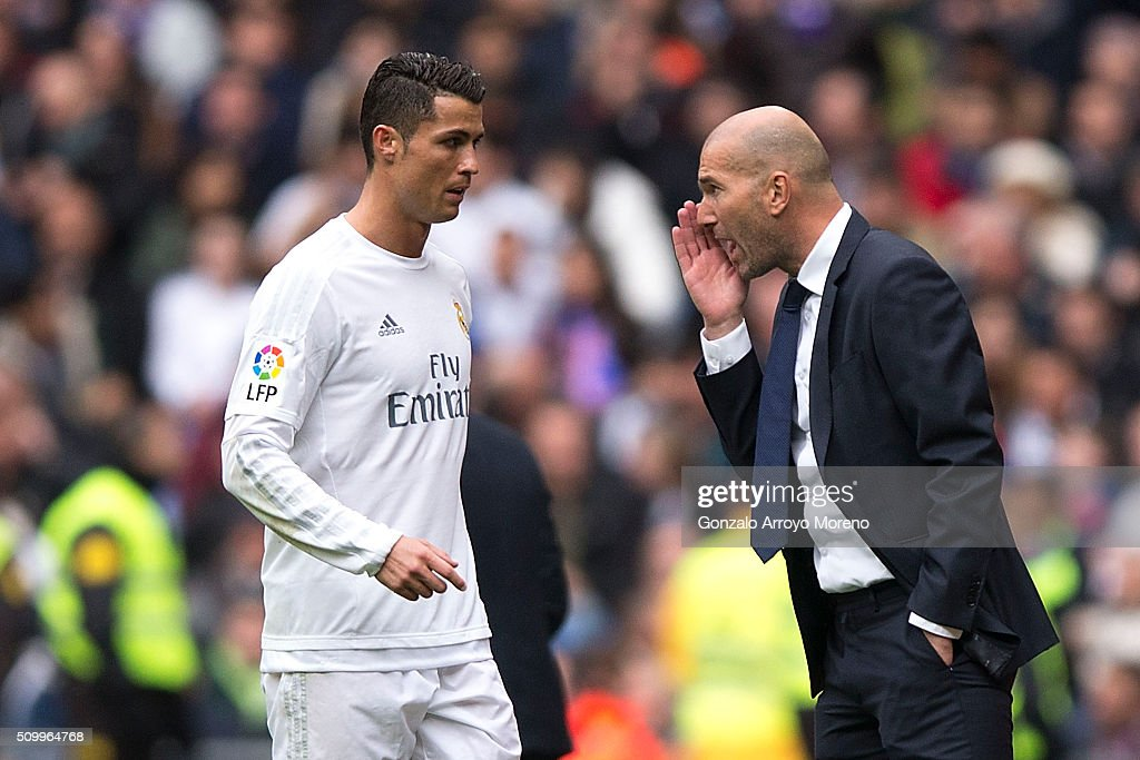 coach <a gi-track='captionPersonalityLinkClicked' href=/galleries/search?phrase=Zinedine+Zidane&family=editorial&specificpeople=172012 ng-click='$event.stopPropagation()'>Zinedine Zidane</a> (R) of Real Madrid CF gives instructions to his player <a gi-track='captionPersonalityLinkClicked' href=/galleries/search?phrase=Cristiano+Ronaldo+-+Fotbollsspelare&family=editorial&specificpeople=162689 ng-click='$event.stopPropagation()'>Cristiano Ronaldo</a> (L) during the La Liga match between Real Madrid CF and Athletic Club at Estadio Santiago Bernabeu on February 13, 2016 in Madrid, Spain.