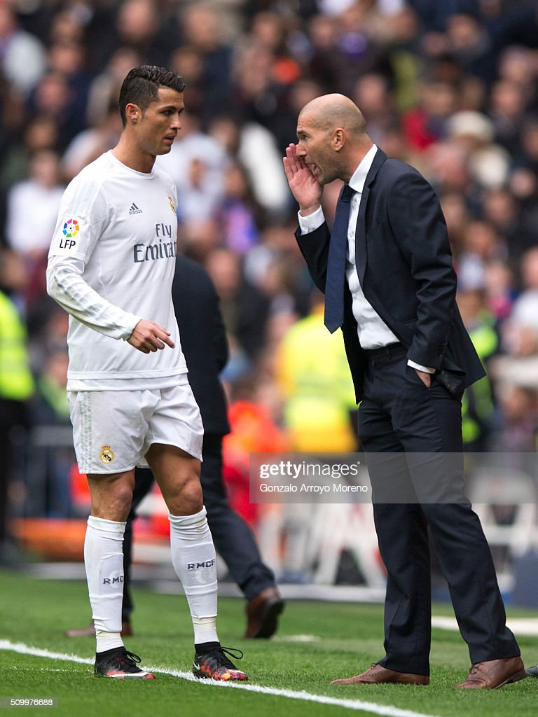 coach <a gi-track='captionPersonalityLinkClicked' href=/galleries/search?phrase=Zinedine+Zidane&family=editorial&specificpeople=172012 ng-click='$event.stopPropagation()'>Zinedine Zidane</a> (R) of Real Madrid CF gives instructions to his player <a gi-track='captionPersonalityLinkClicked' href=/galleries/search?phrase=Cristiano+Ronaldo+-+Jogador+de+futebol&family=editorial&specificpeople=162689 ng-click='$event.stopPropagation()'>Cristiano Ronaldo</a> (L) during the La Liga match between Real Madrid CF and Athletic Club at Estadio Santiago Bernabeu on February 13, 2016 in Madrid, Spain.