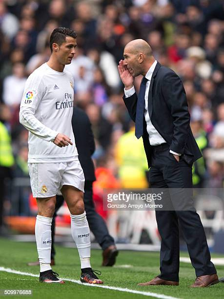 coach Zinedine Zidane of Real Madrid CF gives instructions to his player Cristiano Ronaldo during the La Liga match between Real Madrid CF and...