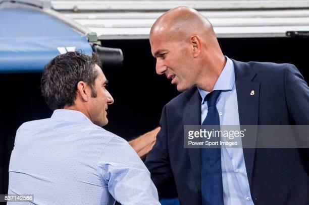 MADRID SPAIN AUGUST 16 Coach Zinedine Zidane of Real Madrid greets coach Luis Enrique Martinez Garcia of FC Barcelona during their Supercopa de...