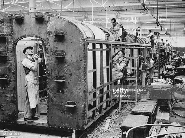 Coachbuilders for Great Western Railway at work on the construction of passenger coaches at the Swindon railway works on 8 February 1937 in Swindon...