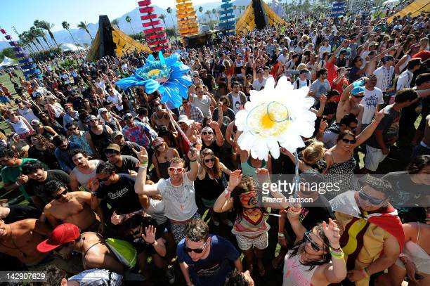 Coachella music fans dance during Day 2 of the 2012 Coachella Valley Music Arts Festival held at the Empire Polo Club on April 14 2012 in Indio...