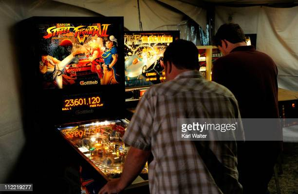 Coachella music fans play pinball games prior to the Coachella Valley Music Arts Festival 2011 held at the Empire Polo Club on April 14 2011 in Indio...