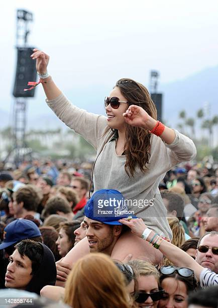 Coachella music fans watch the band Girls perform during Day 1 of the 2012 Coachella Valley Music Arts Festival held at the Empire Polo Club on April...