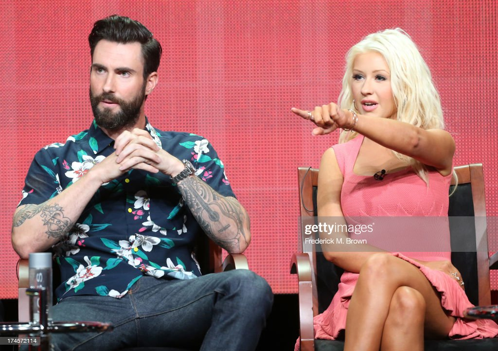 Coaches <a gi-track='captionPersonalityLinkClicked' href=/galleries/search?phrase=Adam+Levine+-+Singer&family=editorial&specificpeople=202962 ng-click='$event.stopPropagation()'>Adam Levine</a> and <a gi-track='captionPersonalityLinkClicked' href=/galleries/search?phrase=Christina+Aguilera&family=editorial&specificpeople=171272 ng-click='$event.stopPropagation()'>Christina Aguilera</a> speak onstage during 'The Voice' panel discussion at the NBC portion of the 2013 Summer Television Critics Association tour - Day 4 at the Beverly Hilton Hotel on July 27, 2013 in Beverly Hills, California.