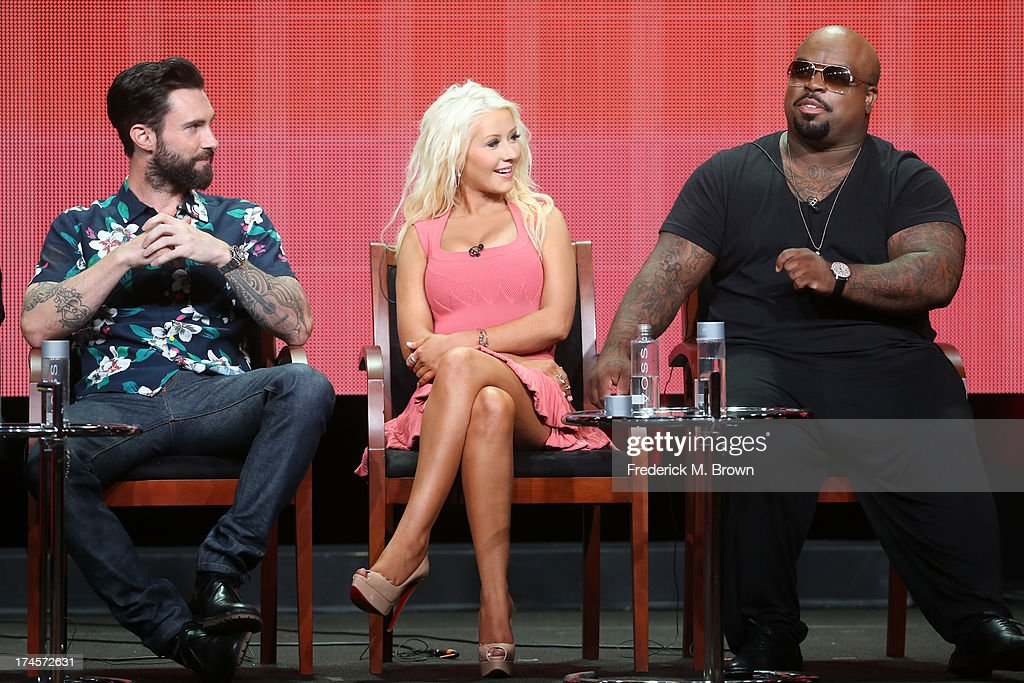 Coaches Adam Levine, Christina Aguilera, and CeeLo Green speak onstage during 'The Voice' panel discussion at the NBC portion of the 2013 Summer Television Critics Association tour - Day 4 at the Beverly Hilton Hotel on July 27, 2013 in Beverly Hills, California.