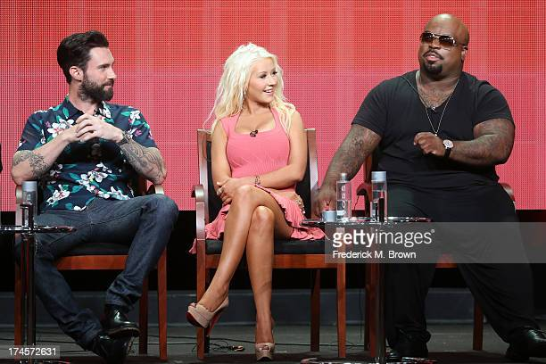 Coaches Adam Levine Christina Aguilera and CeeLo Green speak onstage during 'The Voice' panel discussion at the NBC portion of the 2013 Summer...