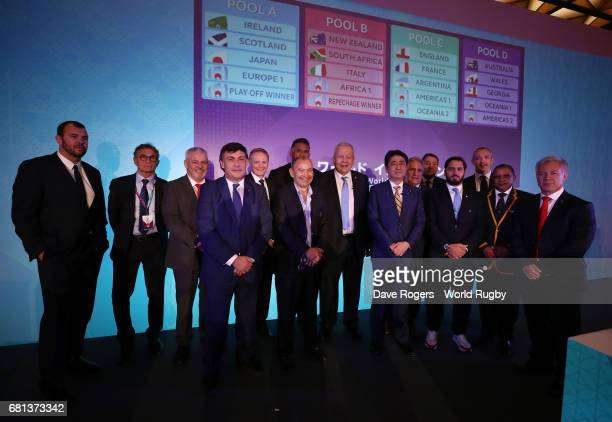 Coaches and Delegates pose alongside Bill Beaumont Chairman of World Rugby Shinzo Abe Prime Minister of Japan and Agustin Pichot ViceChairman of...