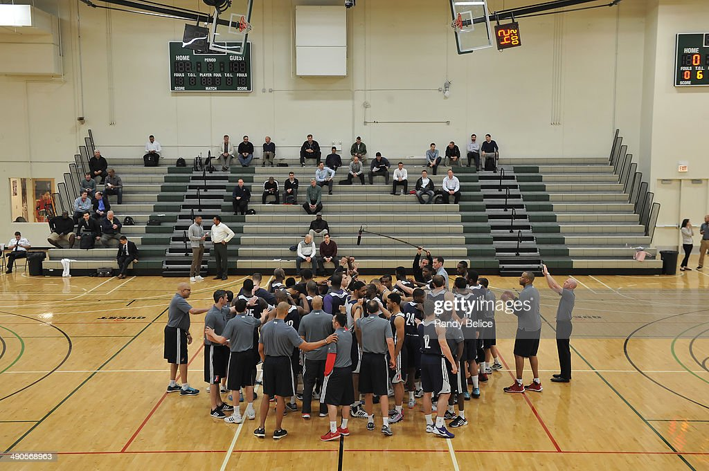 Coaches and players huddle before an audience of NBA scouts on day two of the 2014 NBA Development League Elite Mini Camp on May 13, 2014 at Quest Multisport in Chicago, Illinois.