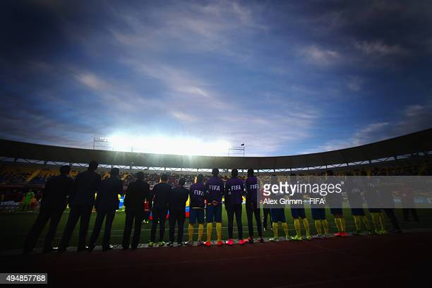 Coaches and substitution players of Ecuador sing their national anthem prior to the FIFA U17 World Cup Chile 2015 Round of 16 match between Russia...
